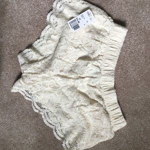 NWT - Cream colored lace booty shorts